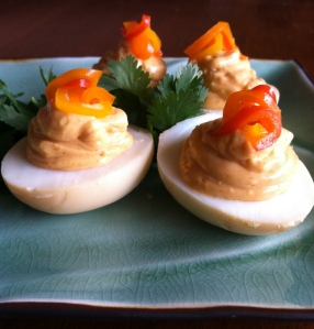 Yolks mashed with roasted garlic, smoked paprika, mayo, and hot sauce. Pickled sweet peppers on top.